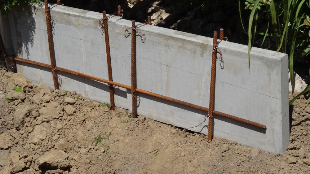 Seitliche Bordsicherung durch Eisen, Stellfriesen und Beton